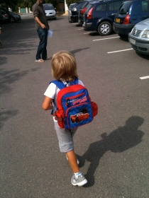 Loves his new backpack...